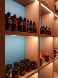 Legacy Gastro Suites, shelves at My C. portray a selection of Premium Products from Greece.